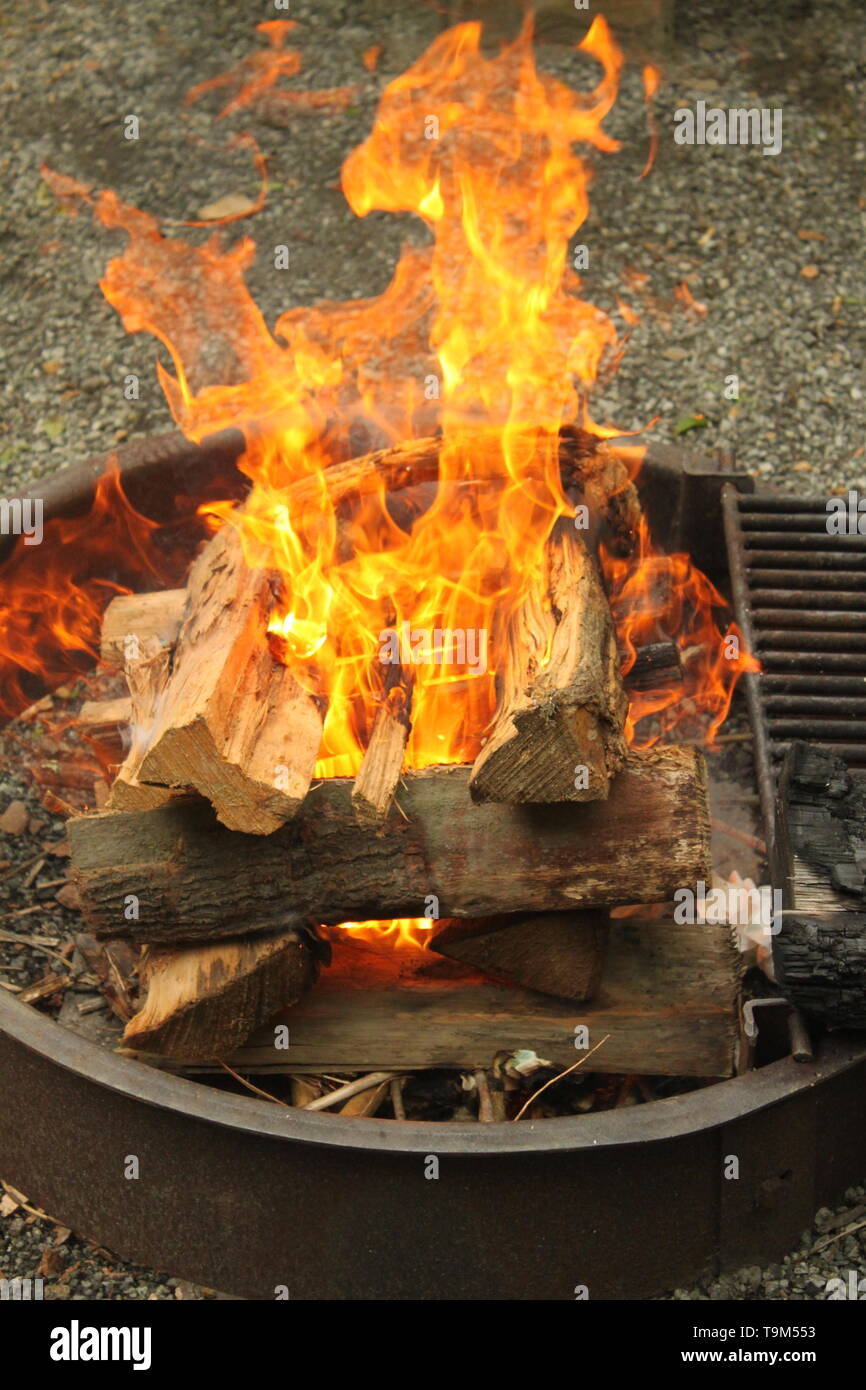 A camp fire on a Cub Scout Camping trip - Stock Image