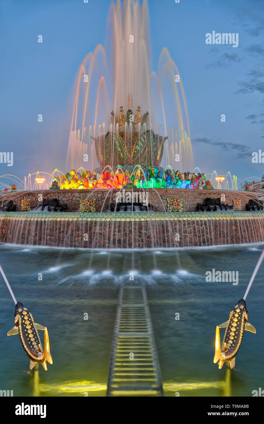 = Stone Flower Fountain and Gilded Fishes in Spring Twilight =  View on the restored Stone Flower fountain with gilded fishes at nice spring evening i - Stock Image