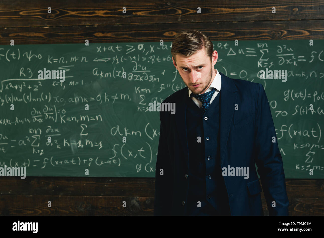 Talented mathematician. Genius solved mathematics problem.Teacher smart student intrested math physics exact sciences. Man formal wear classic suit - Stock Image