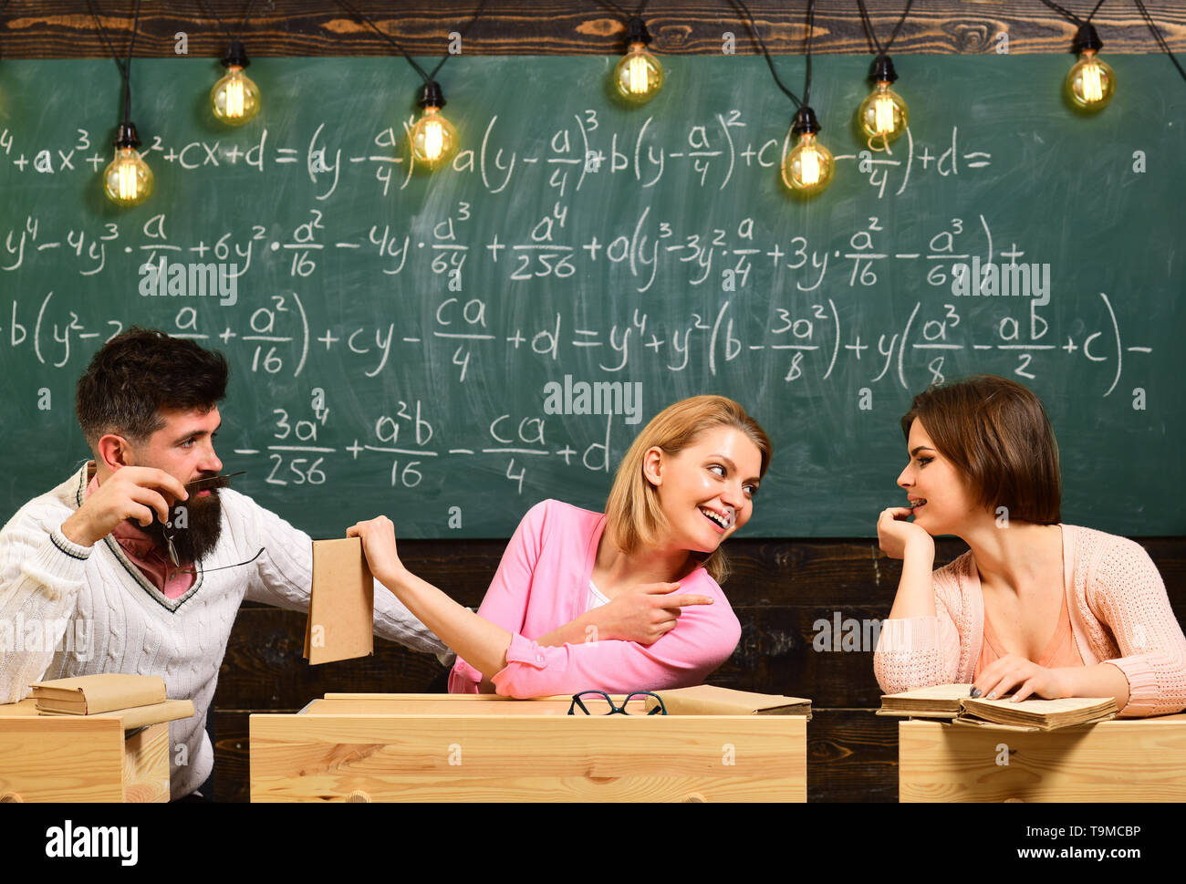 Friendship. Friends make decision and solve problem. Back to school with tutor. Teamwork at education centre. New technology in modern school. Group - Stock Image