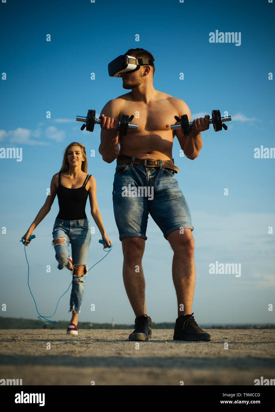Future champions training outdoor. Future victory with new technology. Man use future technology to build muscle. Your vision is your future - Stock Image