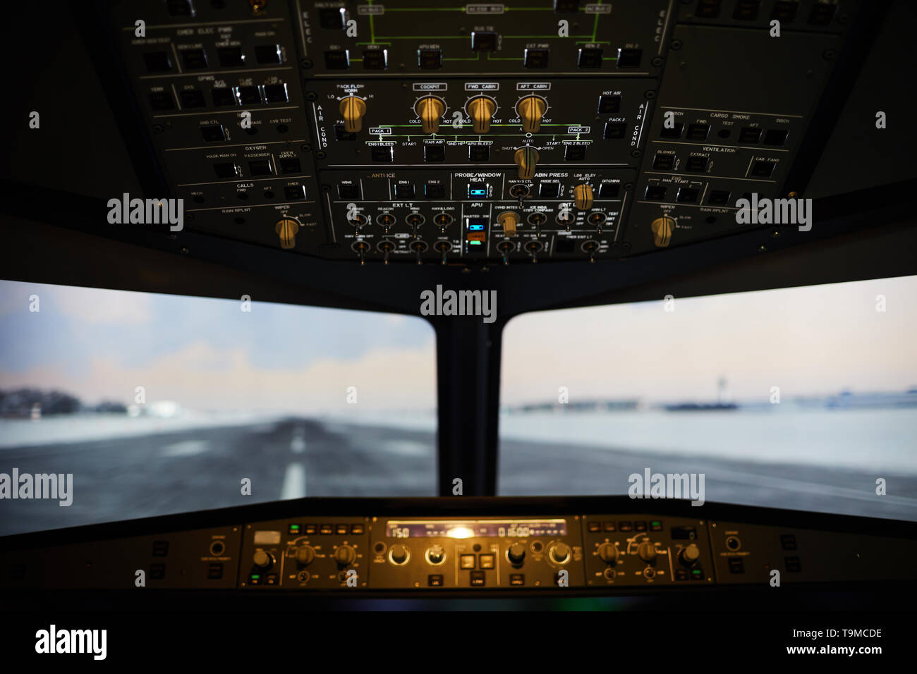 Airstrip view from airplane windshield - Stock Image