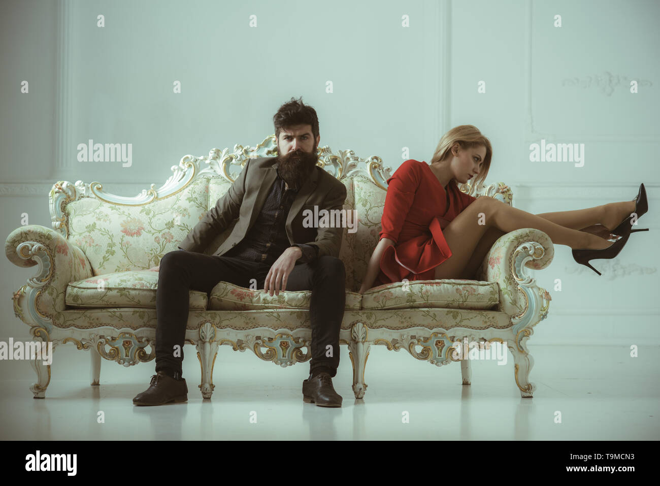 relationship. relationship of man and woman sit alone on one sofa. bad relatioship of cfamily couple. couple relationship breakdown. - Stock Image