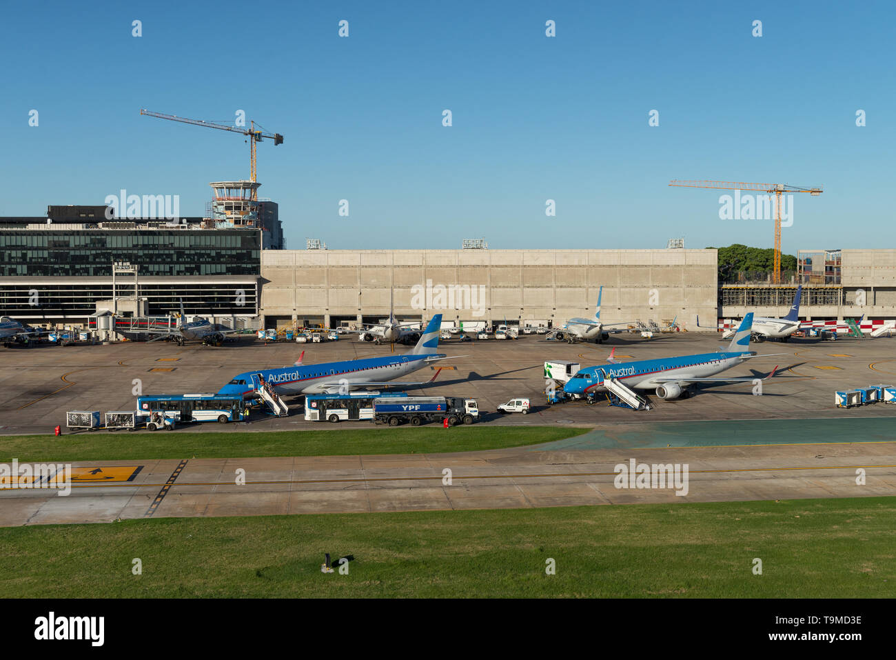 Aerial image showing planes of type Embraer ERJ-190AR of the company Austral boarding at Jorge Newbery Airfield (Spanish: Aeroparque 'Jorge Newbery',  - Stock Image