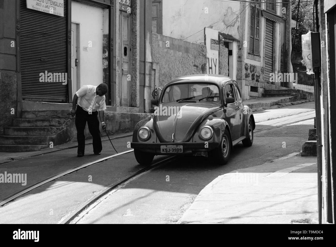Man with VW Beetle in Rio de Janeiro - Stock Image