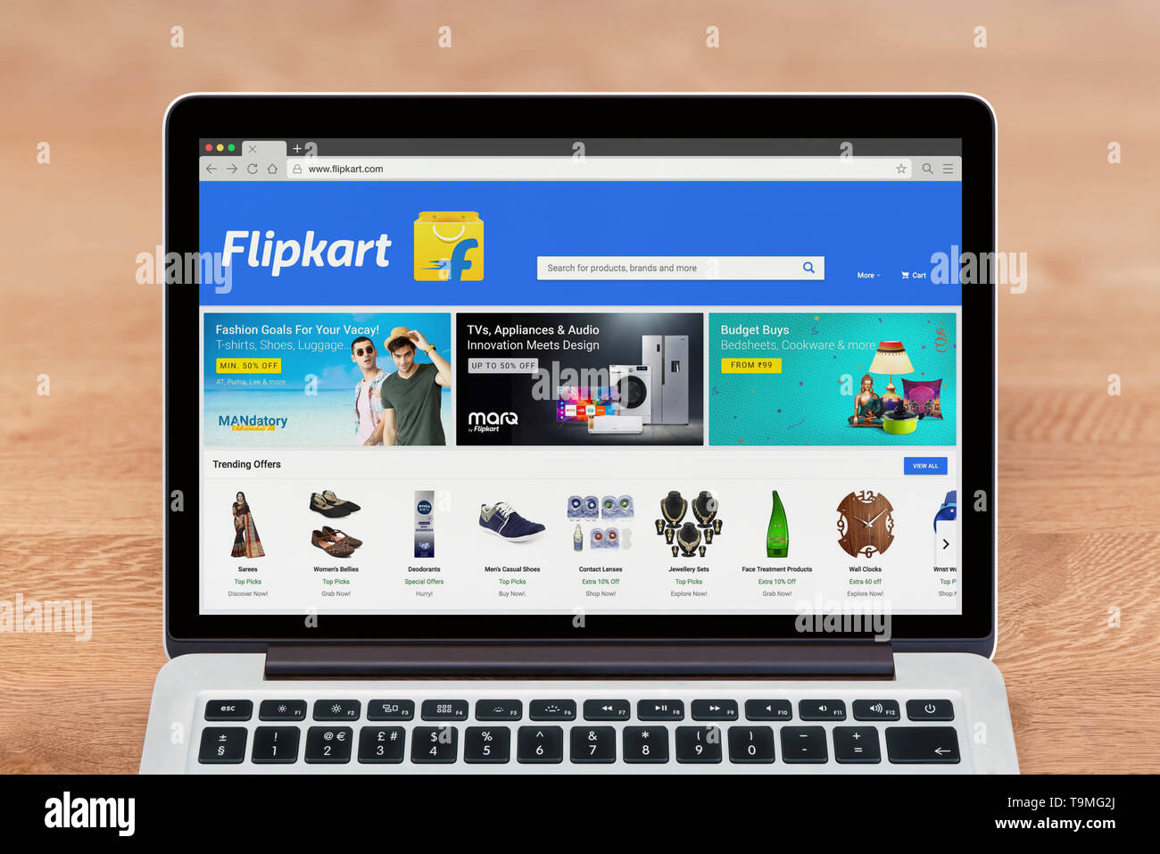 An Apple Macbook displays the Flipkart website (Editorial use only). - Stock Image
