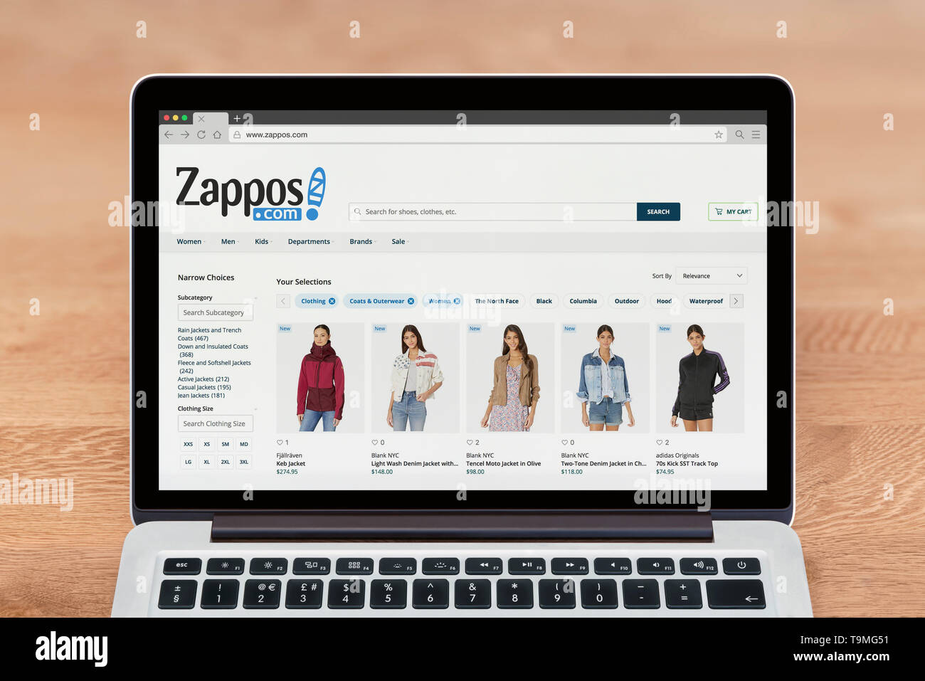 An Apple Macbook displays the Zappos website (Editorial use only). - Stock Image