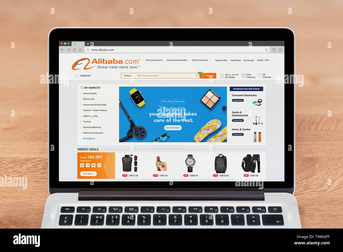 An Apple Macbook displays the Alibaba website (Editorial use only). - Stock Image