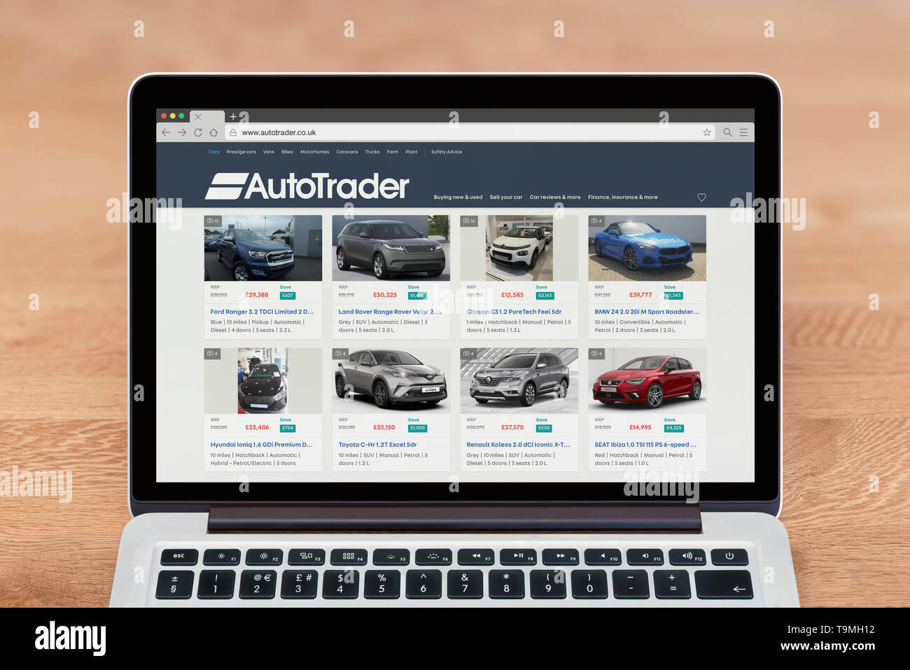An Apple Macbook displays the Autotrader website (Editorial use only). - Stock Image