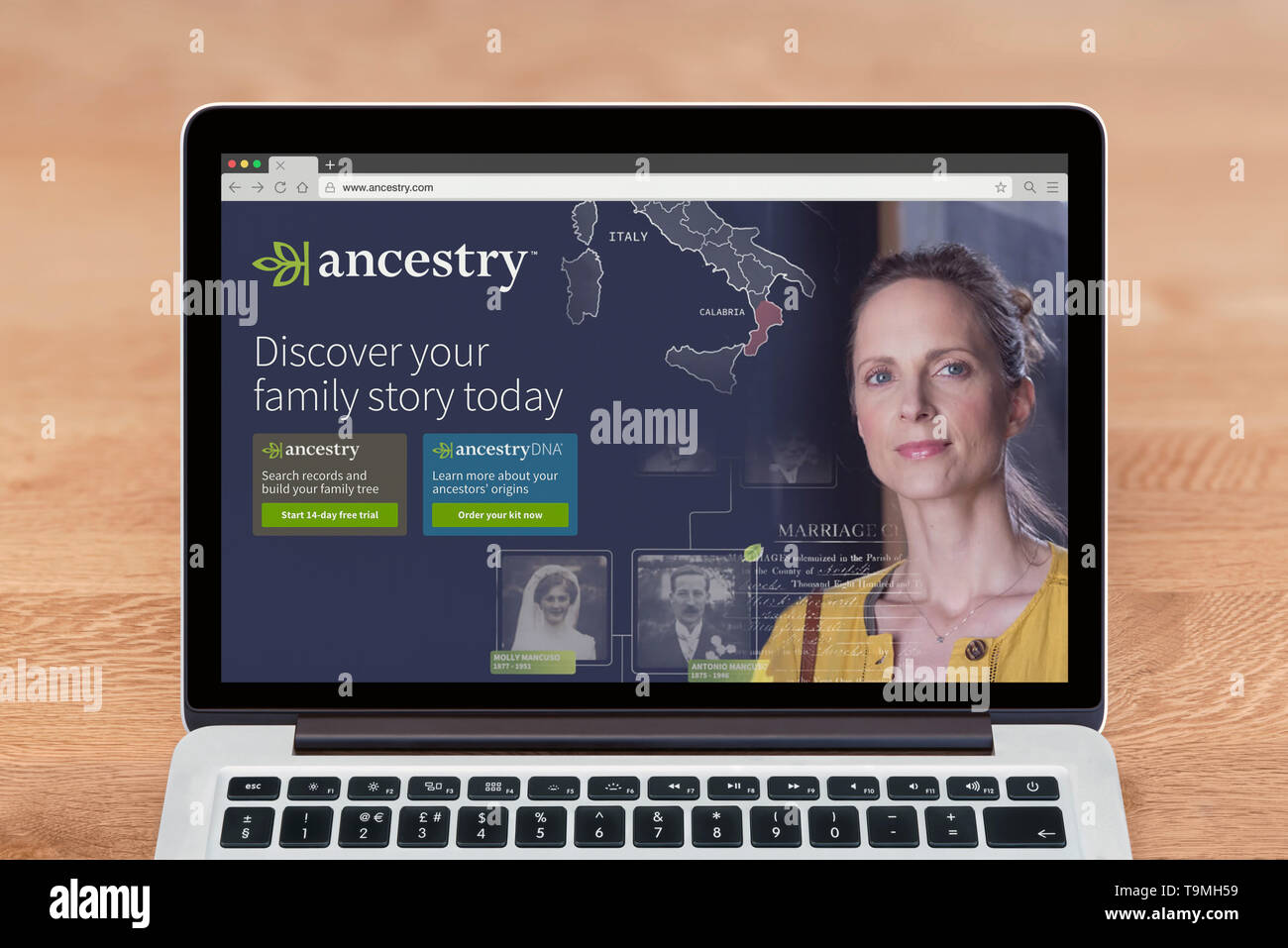 An Apple Macbook displays the Ancestry website (Editorial use only). - Stock Image