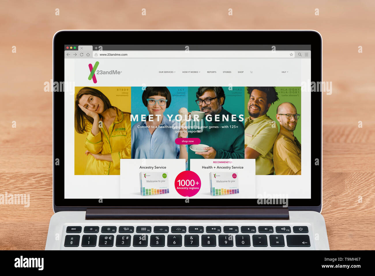 An Apple Macbook displays the 23andme website (Editorial use only). - Stock Image