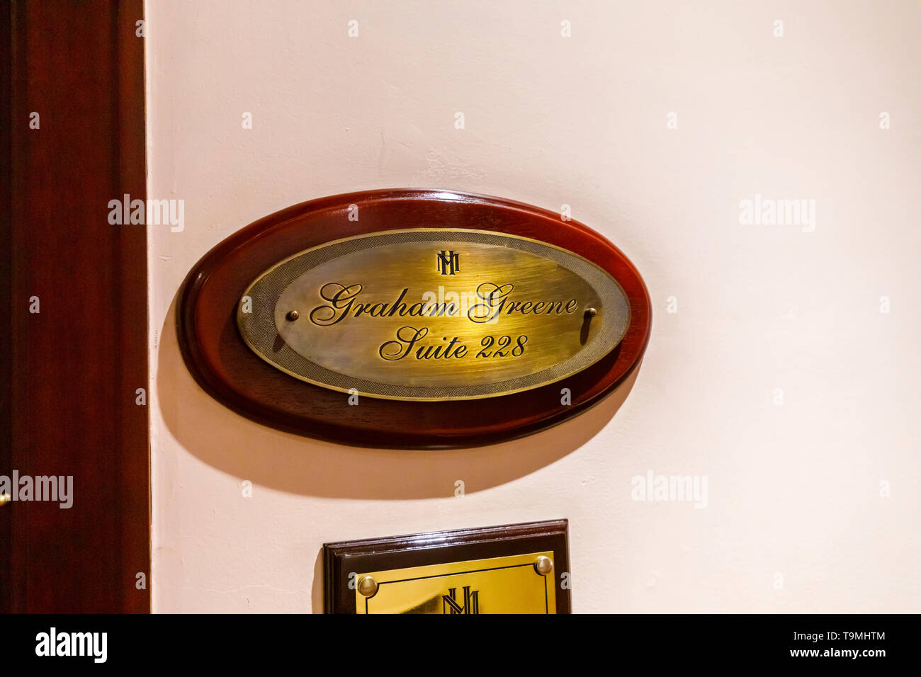 Brass plaque outside the Graham Green Suite, room 228 in the Sofitel Legend Metropole Hanoi hotel, Hanoi, north Vietnam, south-east Asia Stock Photo