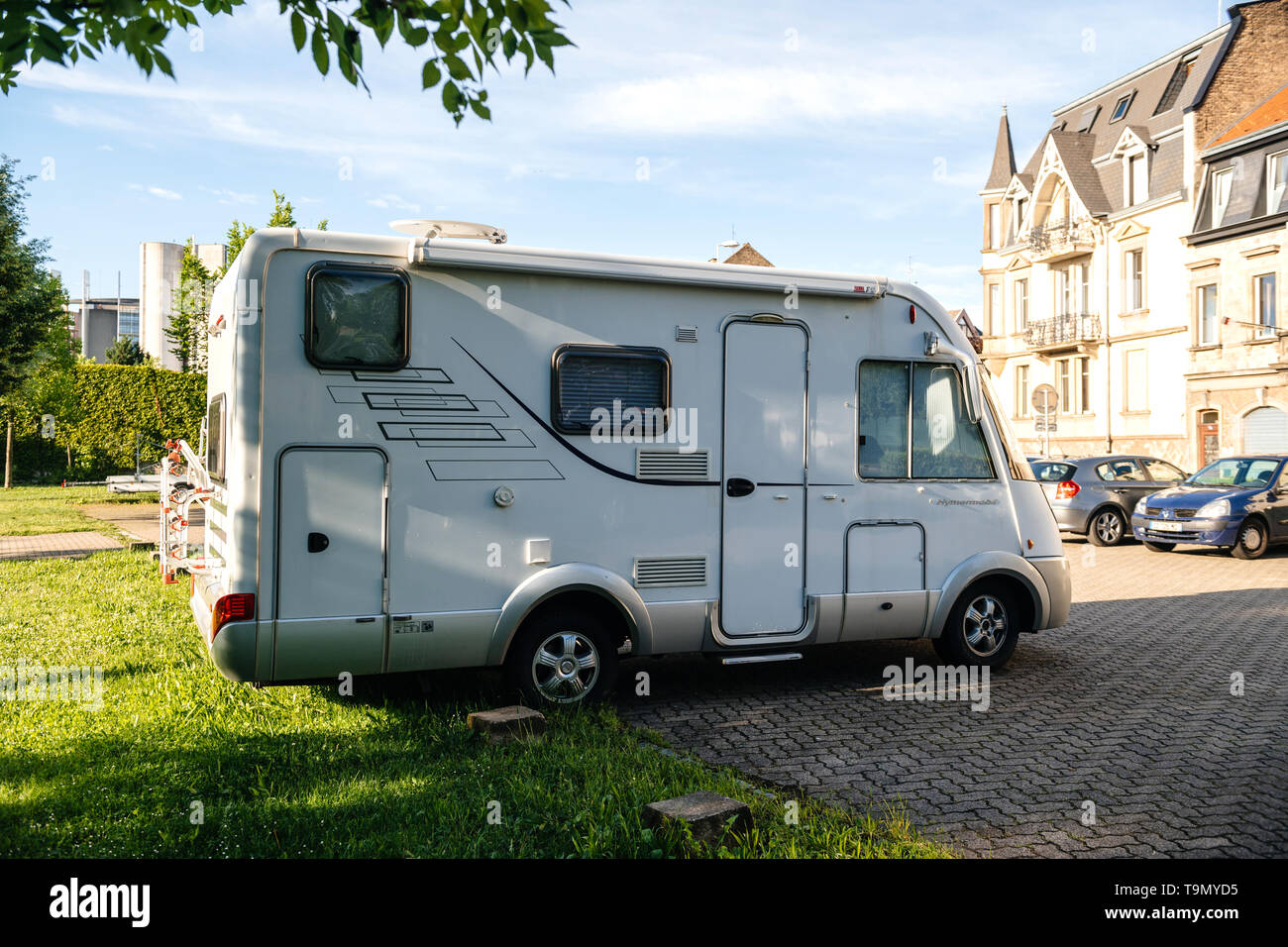 Strasbourg, France - May 19, 2017: Hymermobil RV white van parked on parked space in French city - Stock Image