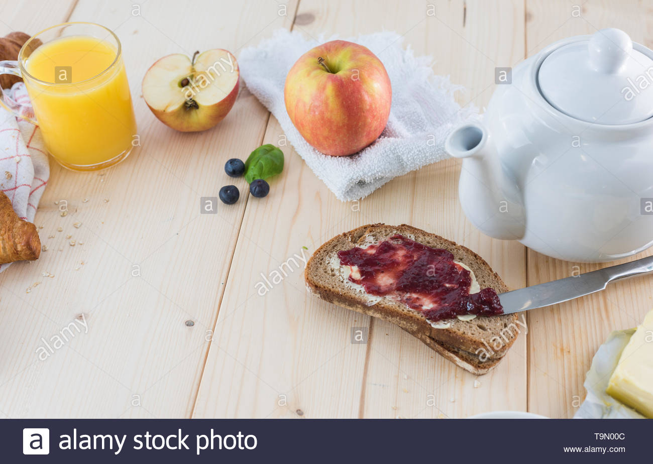 Breakfast on a wooden simple table.  Croissants Breakfast with aromatic tast. Good morning, great start to the day. - Stock Image