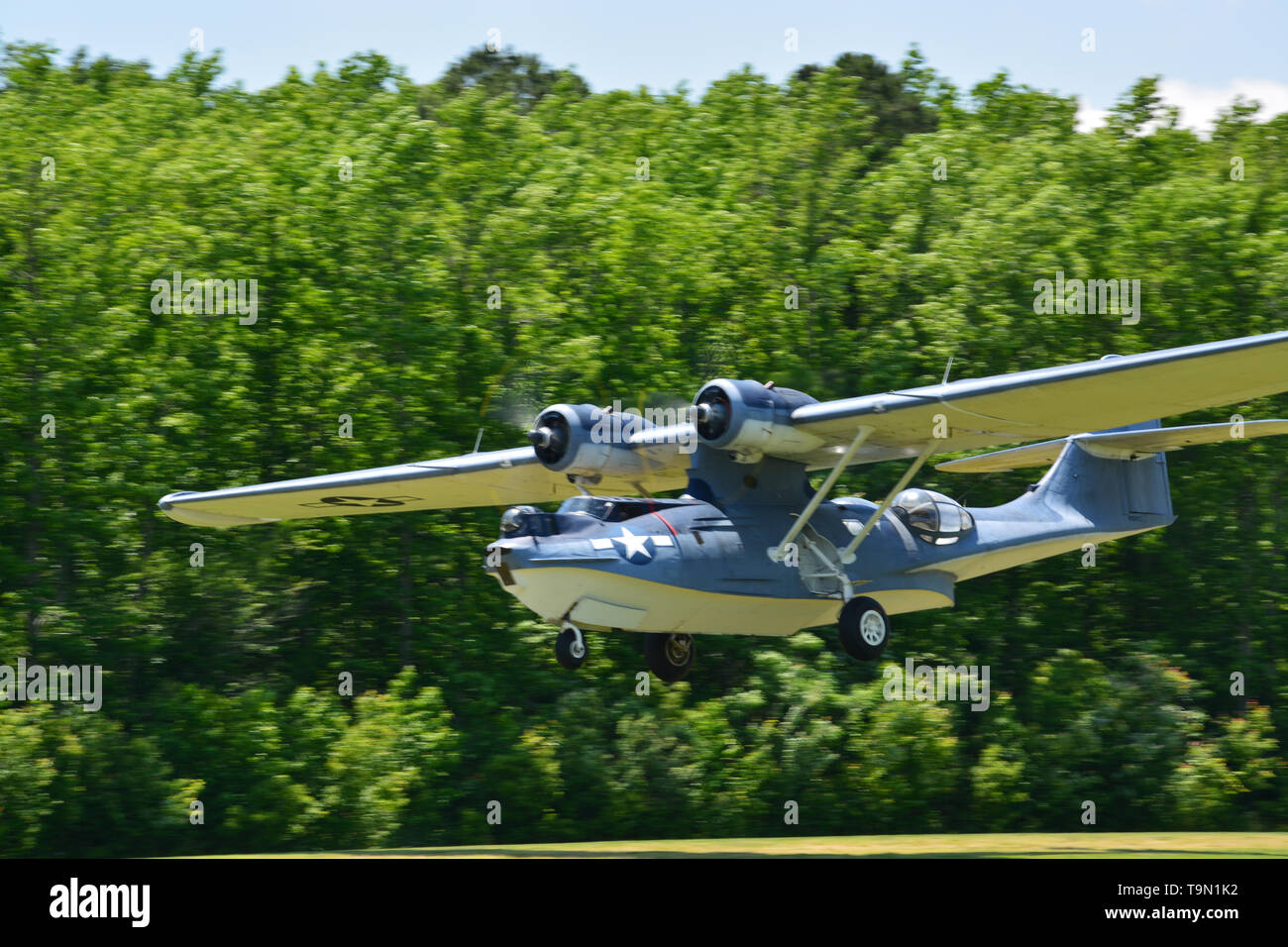 A restored PBY Catalina during takeoff in the 2019 Virginia Beach Military Aviation Museum WWII show. - Stock Image