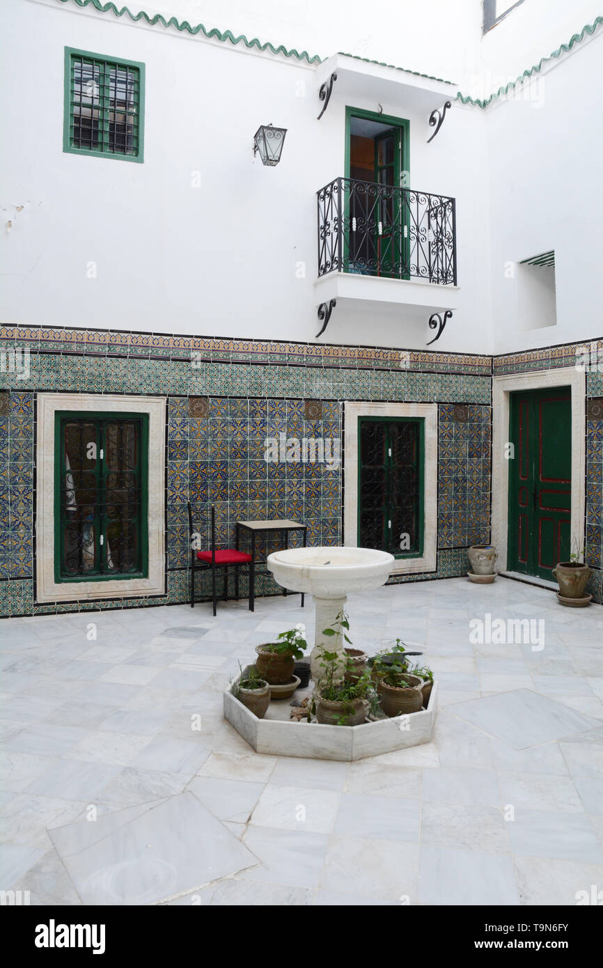 Islamic architectural motifs and tile work in the open-air courtyard of a traditional 16th century home in the medina (old city) of Tunis, Tunisia. Stock Photo
