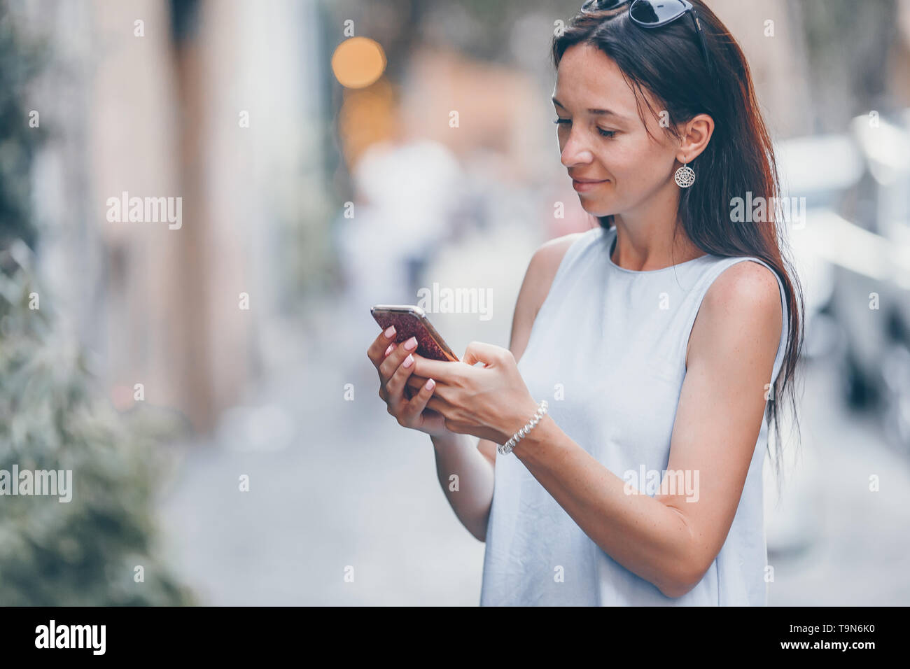 Young woman walking along the deserted streets of Europe. - Stock Image