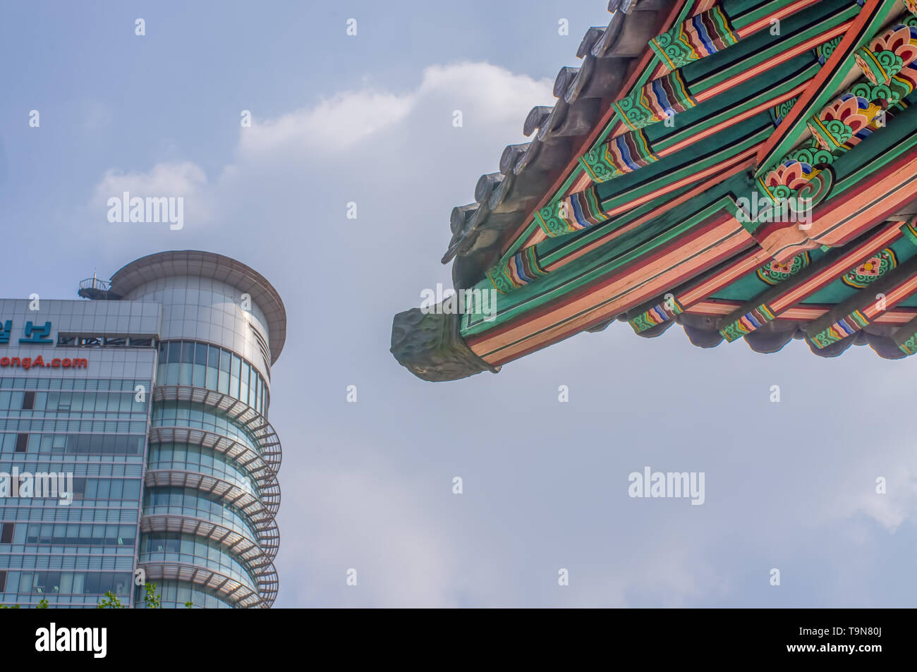 SEOUL / SOUTH KOREA - JUNE 24, 2013: Traditional temple with modern skyscraper in background - Historic culture and economic future - Seoul, South Kor - Stock Image