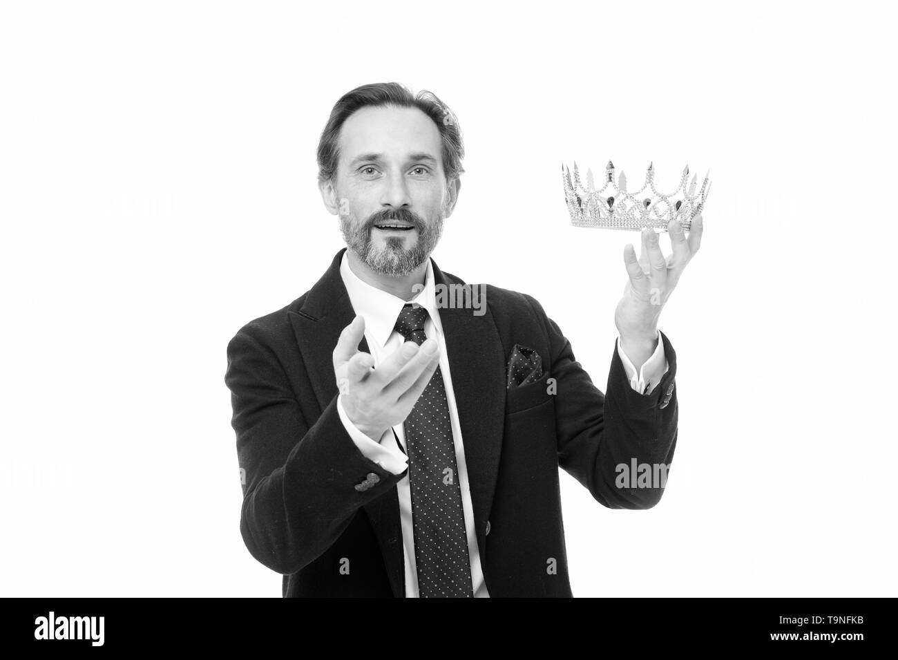 Keeper of the jewel. Achieving success in business. Business king. Mature businessman holding crown. Senior man representing power and triumph. King o Stock Photo