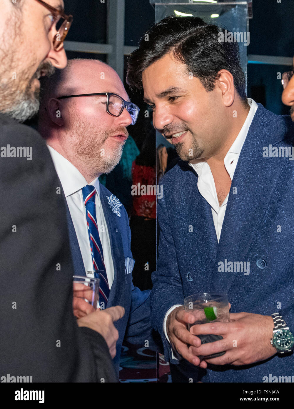 Washington, DC. 26th Apr, 2019. Qatar's Ambassador to the United States, Sheikh Meshal Bin Hamad Al-Thani, right, smiles during a conversation with Paul Hamill, of Logan International Relations and executive director of the Qatar-America Institute, left center, during Qatar's White House Correspondents Association pre-party in Washington, DC, on April 26, 2019. Credit: Ron Sachs/CNP | usage worldwide Credit: dpa/Alamy Live News - Stock Image