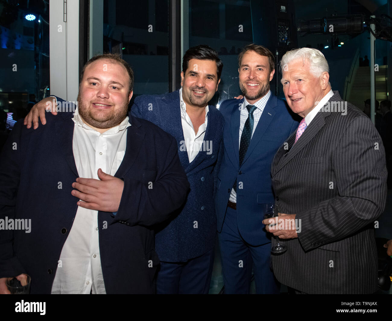 Washington, DC. 26th Apr, 2019. From left to right: Washington Post reporter Josh Dawsey, Qatar's Ambassador to the United States, Sheikh Meshal Bin Hamad Al-Thani, an unknown man, and former Congressman Jim Moran pose for a photo during Qatar's White House Correspondents Association pre-party in Washington, DC, on April 26, 2019. Credit: Ron Sachs/CNP | usage worldwide Credit: dpa/Alamy Live News - Stock Image