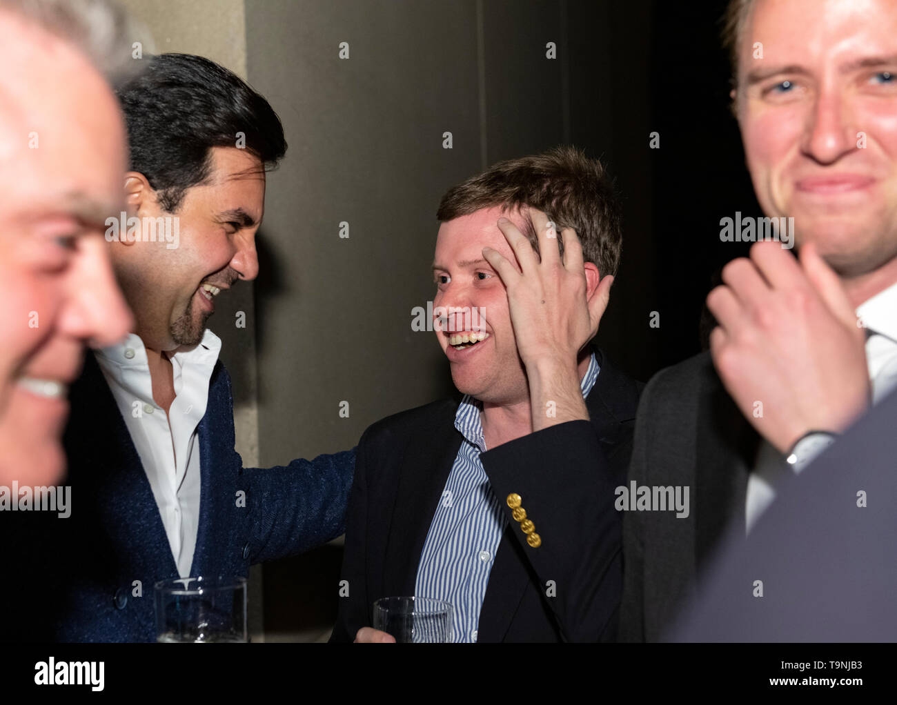 Washington, DC. 26th Apr, 2019. Former Trump campaign and administration official Matt Mowers, right, turns away to laugh as Qatar-America Institute advisory board member Andrew Bowen, right center, shares a humorous story with a laughing Sheikh Meshal Bin Hamad Al-Thani, Qatar's Ambassador to the United States, left center, and an unknown man, left, during Qatar's White House Correspondents Association pre-party in Washington, DC, on April 26, 2019. Credit: Ron Sachs/CNP | usage worldwide Credit: dpa/Alamy Live News - Stock Image