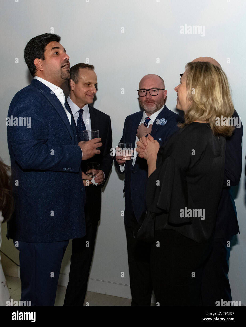 Washington, DC. 26th Apr, 2019. Qatar's Ambassador to the United States, Sheikh Meshal Bin Hamad Al-Thani, left, speaks with a small group of partygoers, including Qatar-America Institute Executive Director Paul Hamil, right center, during Qatar's White House Correspondents Association pre-party in Washington, DC, on April 26, 2019. Credit: Ron Sachs/CNP | usage worldwide Credit: dpa/Alamy Live News - Stock Image