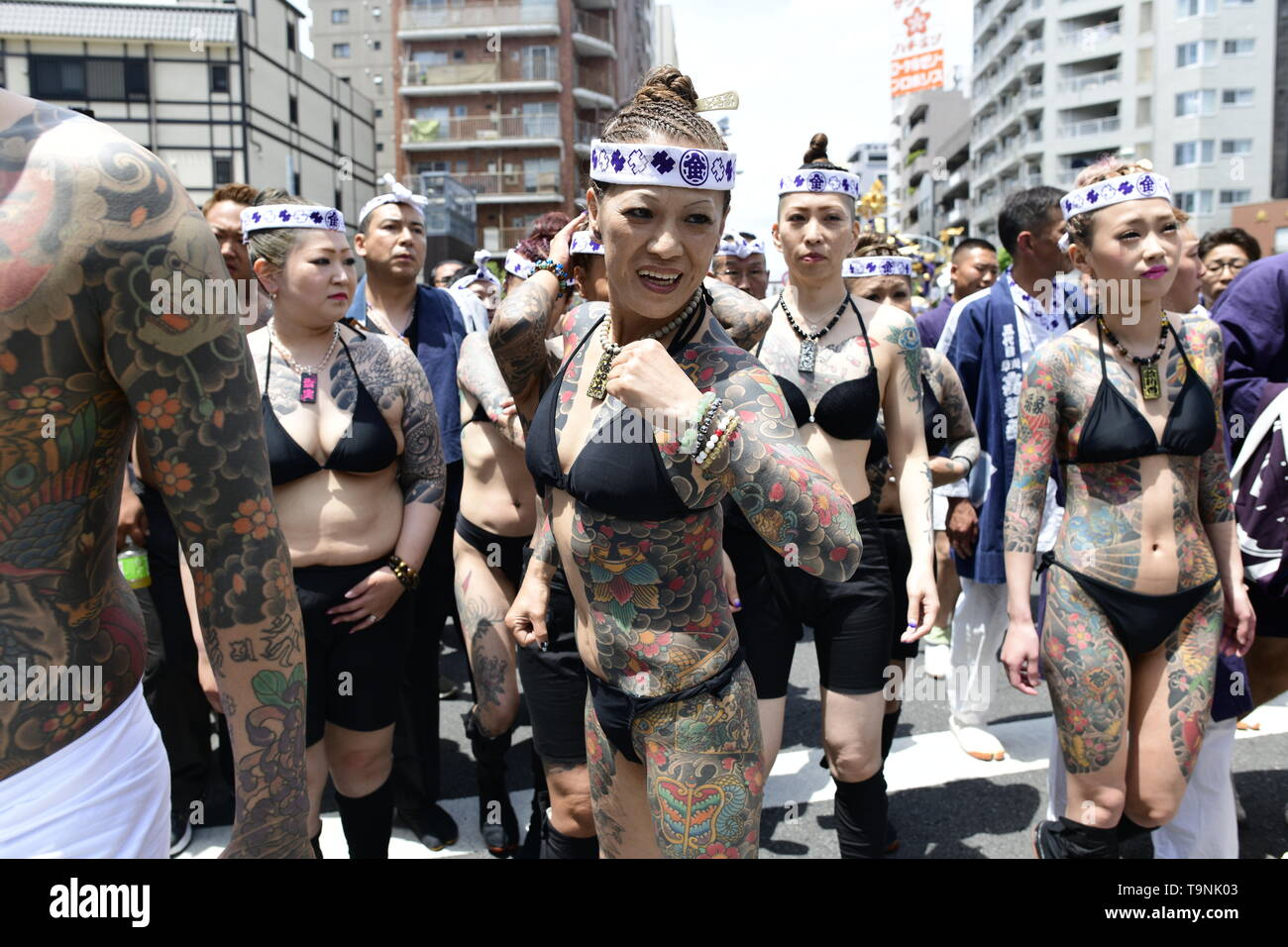 """TOKYO, JAPAN - MAY 18: Heavily tattooed Japanese men and women walk in the street of Asakusa during """"Sanja Matsuri"""" on May 18, 2019 in Tokyo, Japan. A boisterous traditional mikoshi (portable shrine) is carried in the streets of Asakusa to bring goodluck, blessings and prosperity to the area and its inhabitants. (Photo: Richard Atrero de Guzman/ AFLO) Stock Photo"""