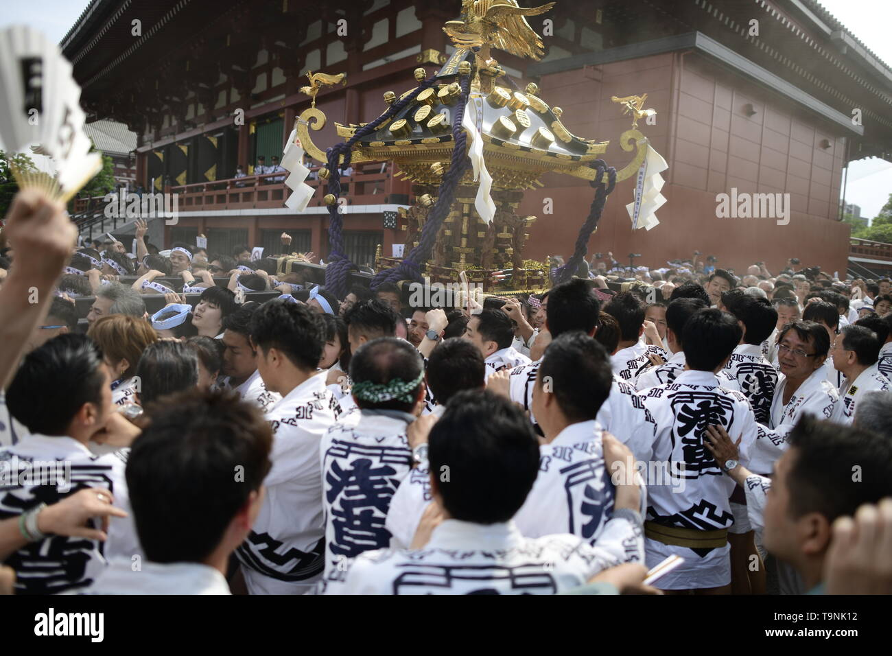 """TOKYO, JAPAN - MAY 18: Participants clad in traditional happi coats carry a portable shrine near Sensoji Temple during Tokyo's one of the largest three day festival called """"Sanja Matsuri"""" on May 18, 2019 in Tokyo, Japan. A boisterous traditional mikoshi (portable shrine) is carried in the streets of Asakusa to bring goodluck, blessings and prosperity to the area and its inhabitants. (Photo: Richard Atrero de Guzman/ AFLO) Stock Photo"""
