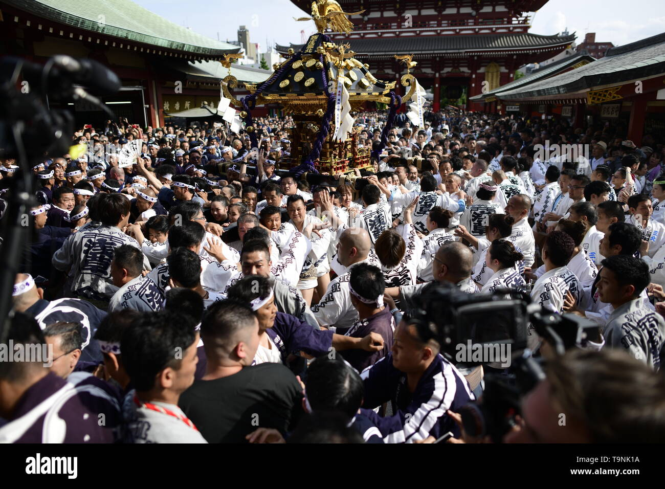 "TOKYO, JAPAN - MAY 18: Participants clad in traditional happi coats carry a portable shrine in front of Sensoji Temple during Tokyo's one of the largest three day festival called ""Sanja Matsuri"" on May 18, 2019 in Tokyo, Japan. A boisterous traditional mikoshi (portable shrine) is carried in the streets of Asakusa to bring goodluck, blessings and prosperity to the area and its inhabitants. (Photo: Richard Atrero de Guzman/ AFLO) Stock Photo"
