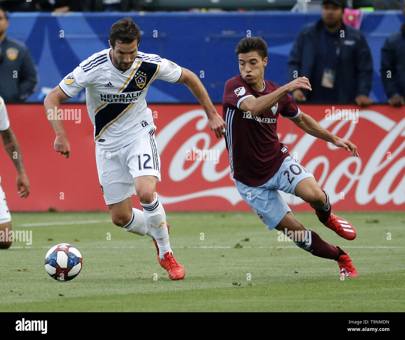 Los Angeles, California, USA. 19th May, 2019. LA Galaxy forward Chris Pontius (12) and Colorado Rapids midfielder Nicol''¡s Mezquida (20) of Uruguay vie for the ball during the 2019 Major League Soccer (MLS) match between LA Galaxy and Colorado Rapids in Carson, California, May 19, 2019. Credit: Ringo Chiu/ZUMA Wire/Alamy Live News - Stock Image