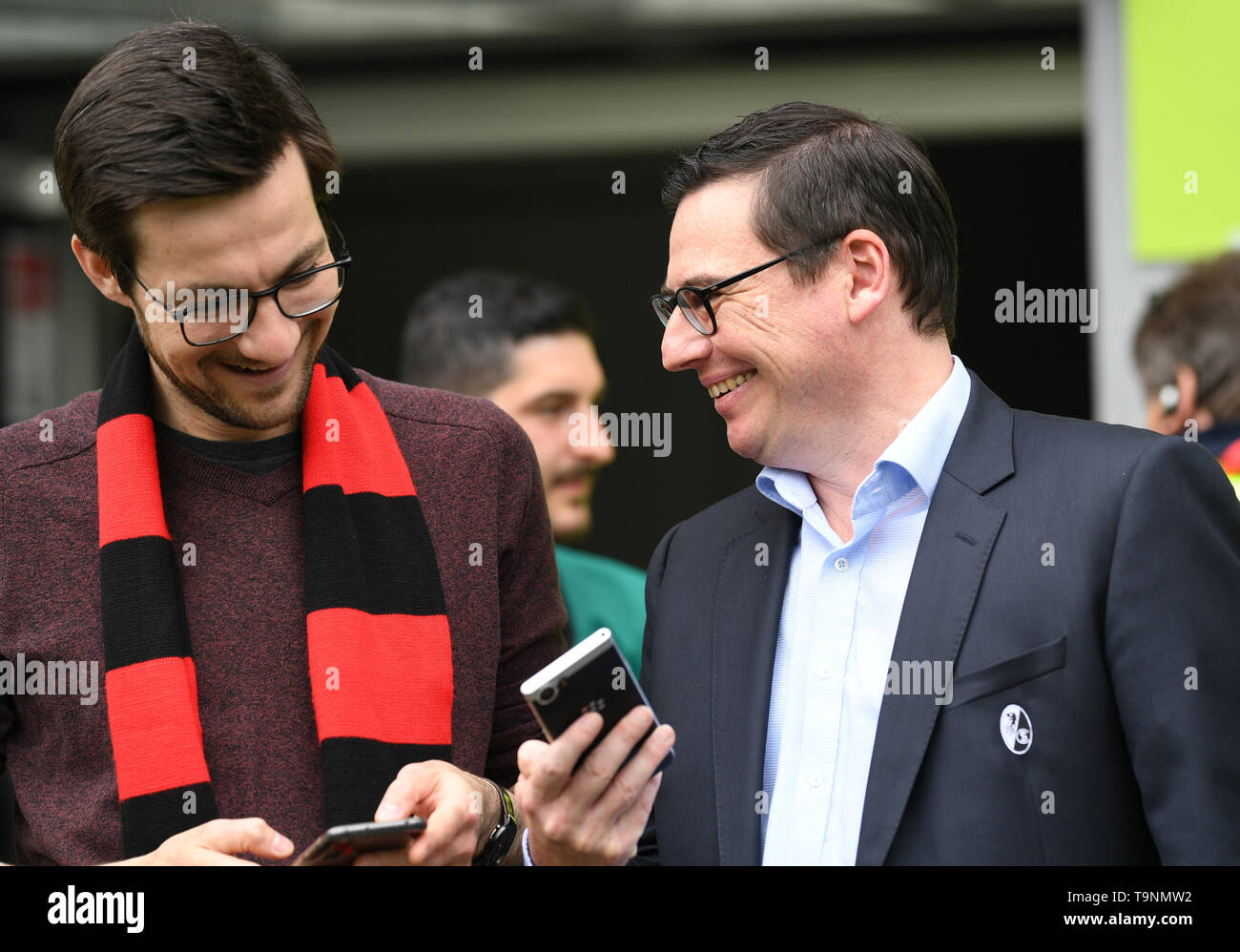 Freiburg, Germany. 18th May, 2019. Soccer: Bundesliga, SC Freiburg - 1st FC Nuremberg, 34th matchday in the Schwarzwaldstadion. Martin Horn (l), Lord Mayor of Freiburg, talks to Oliver Leki (r), Managing Director of SC Freiburg, before the match. Credit: Patrick Seeger/dpa - Use only after contractual agreement/dpa/Alamy Live News - Stock Image