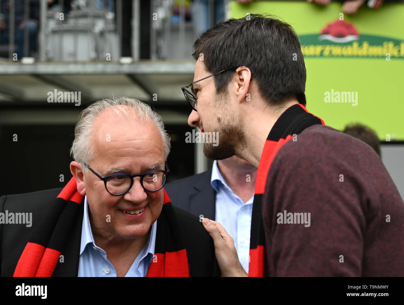Freiburg, Germany. 18th May, 2019. Soccer: Bundesliga, SC Freiburg - 1st FC Nuremberg, 34th matchday in the Schwarzwaldstadion. Martin Horn (r), Lord Mayor of Freiburg, talks to Fritz Keller, President of SC Freiburg, before the match. Credit: Patrick Seeger/dpa - Use only after contractual agreement/dpa/Alamy Live News - Stock Image