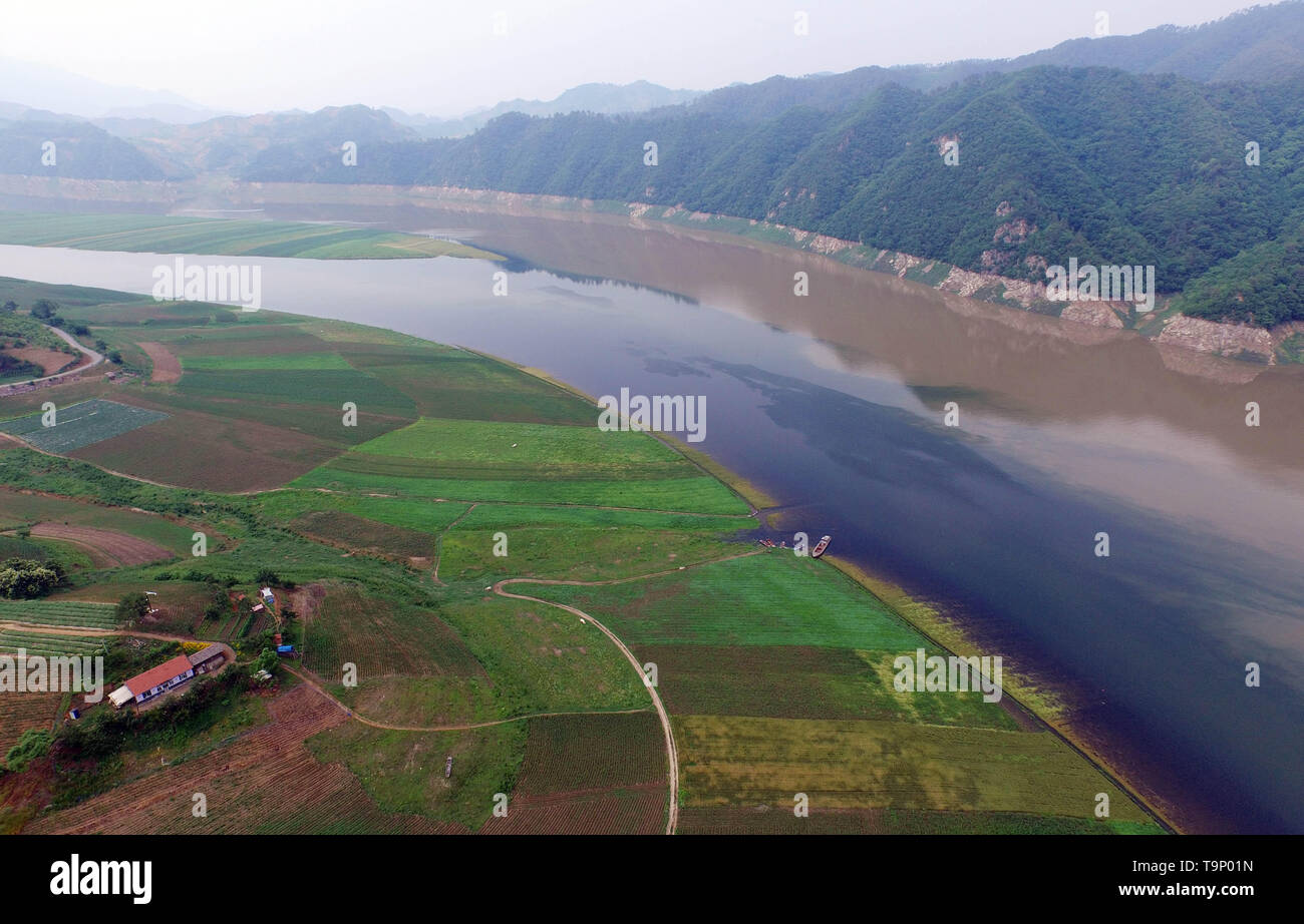 (190520) -- BEIJING, May 20, 2019 (Xinhua) -- Aerial photo taken on June 17, 2016 shows the Yalu River which flows past Lyujiang Village of Zhenjiang Township, Kuandian Manchu Autonomous County, Dandong, northeast China's Liaoning Province. Liaoning Province is located in the southern part of Northeast China, with the Bohai Sea and the Yellow Sea lying to its south. Over the years, the provincial government has prioritized ecological development and set environmental improvement at the core of its agenda. The province's ecological conditions have been improving thanks to systematic conservatio - Stock Image