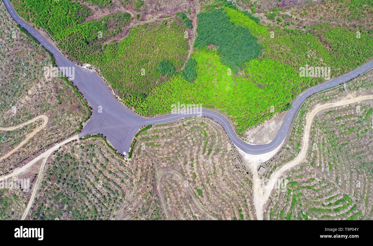(190520) -- BEIJING, May 20, 2019 (Xinhua) -- Aerial photo taken on May 7, 2019 shows terraced fields in Dalishu Village of Dandong, northeast China's Liaoning Province. Liaoning Province is located in the southern part of Northeast China, with the Bohai Sea and the Yellow Sea lying to its south. Over the years, the provincial government has prioritized ecological development and set environmental improvement at the core of its agenda. The province's ecological conditions have been improving thanks to systematic conservation of the natural environment, overall management of the rural environme - Stock Image