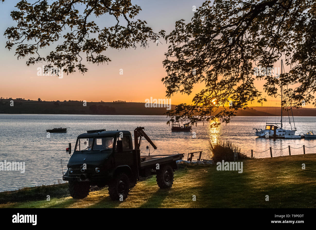Courtmacsherry, Cork, Ireland. 20th May, 2019. A  classic 1960's Mercedes Unimog 404 flatbed truck parked near the waters edge in Courtmacsherry, Co. Cork, Ireland. Credit; David Creedon / Alamy Live News - Stock Image