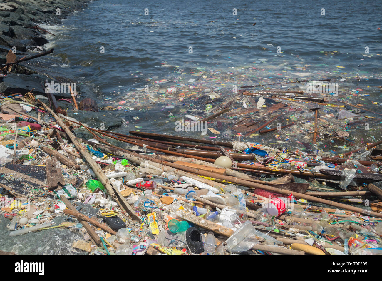 Manila, Philippines - May, 18, 2019: Ocean plastic pollution in Manila Bay shore - Stock Image