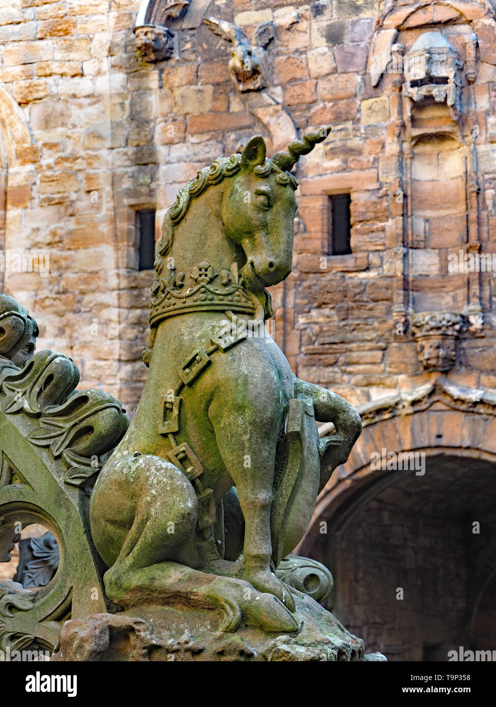 LINLITHGOW, SCOTLAND - SEPTEMBER 2016:  The central courtyard of Linlithgow Palace contains an ornate fountain with numerous statutes of mythical crea Stock Photo