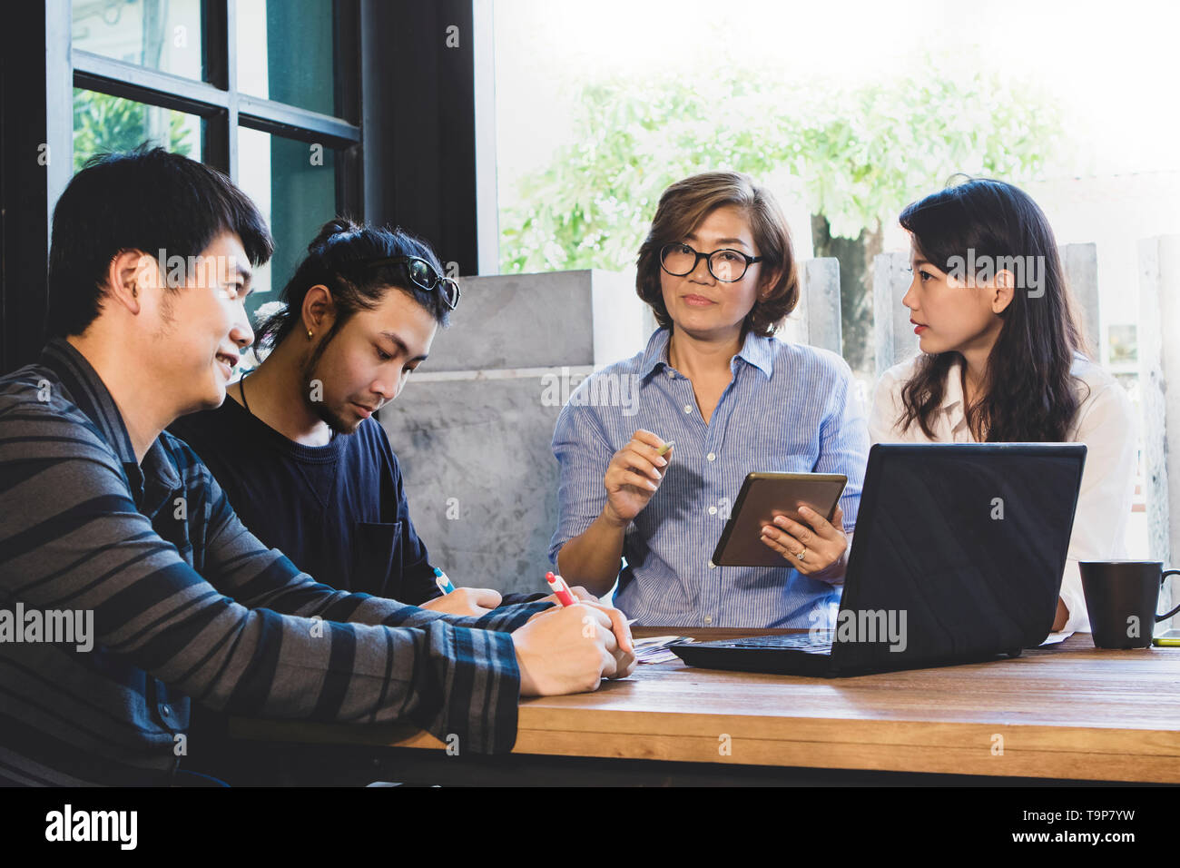 team of man and woman freelance meeting for working solution in home office - Stock Image