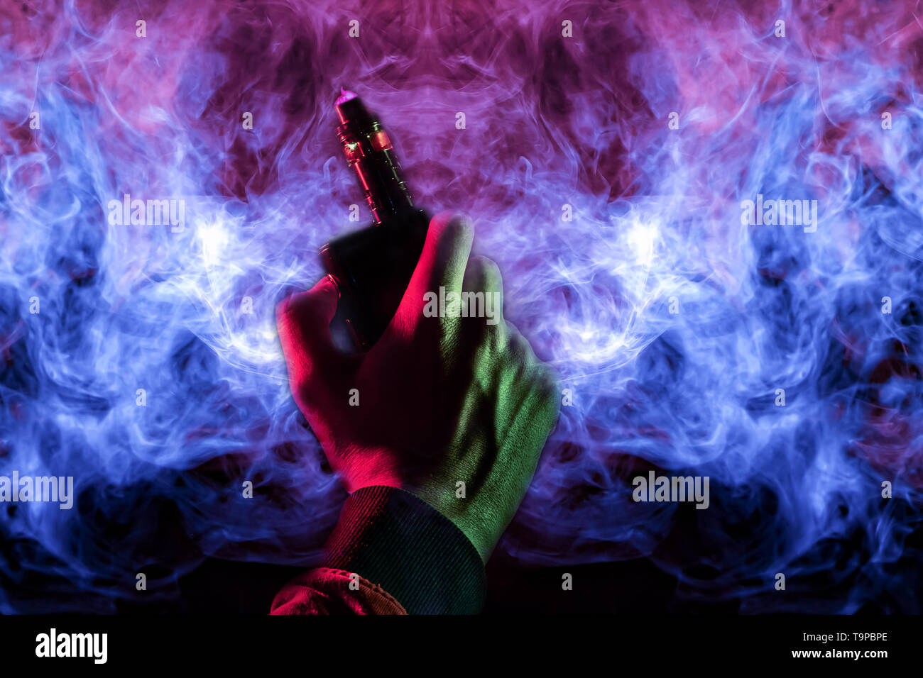 A man body part arm and hand view with green light in a orange hoodie smokes a vape and exhales a red smoke on bright blue and pink wavy background. H - Stock Image