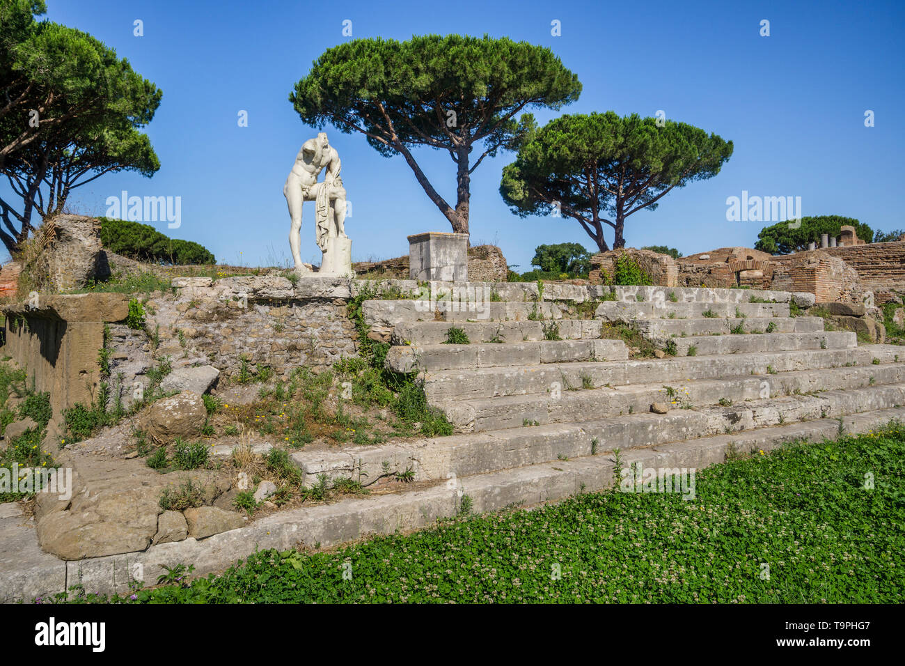 marble statue dedicated to Hercules at Tempio di Ercole, the Temple of Hercules, archeological site of the Roman settlement of Ostia Antica, the ancie - Stock Image