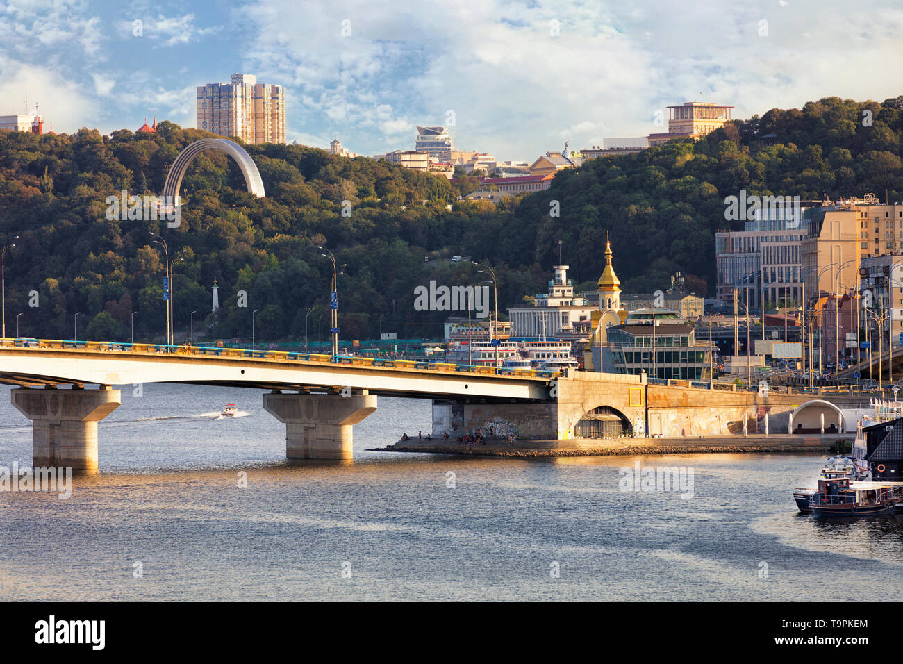 View of the Havana Bridge across the Dnipro River in Kiev in the rays of the evening sunset - Stock Image