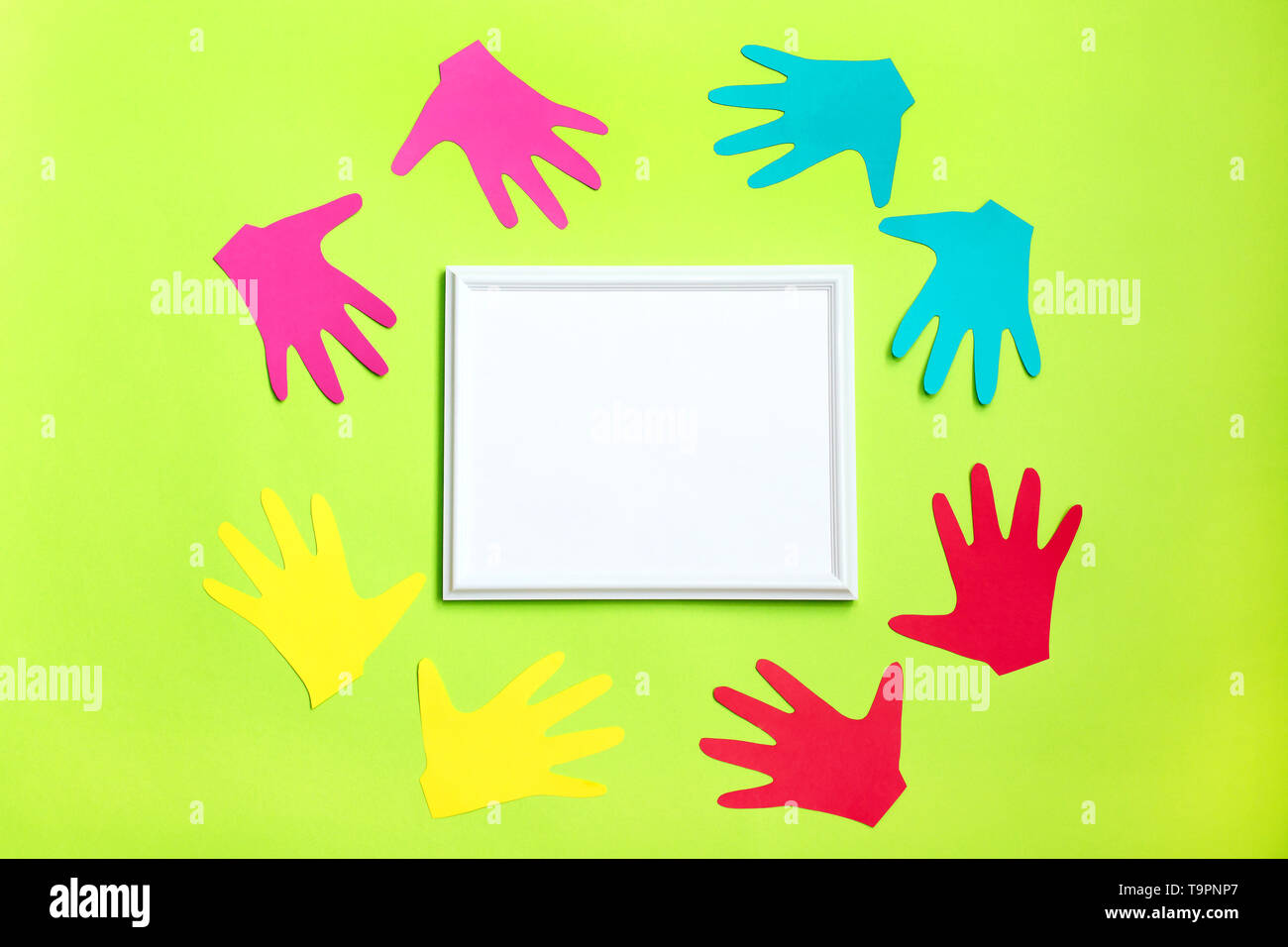 Colourful Painted Hands Around White Frame On Green Background Family Concept Symbol Unity Growth Ready For Your Logo Expressing Positivity Conce Stock Photo Alamy