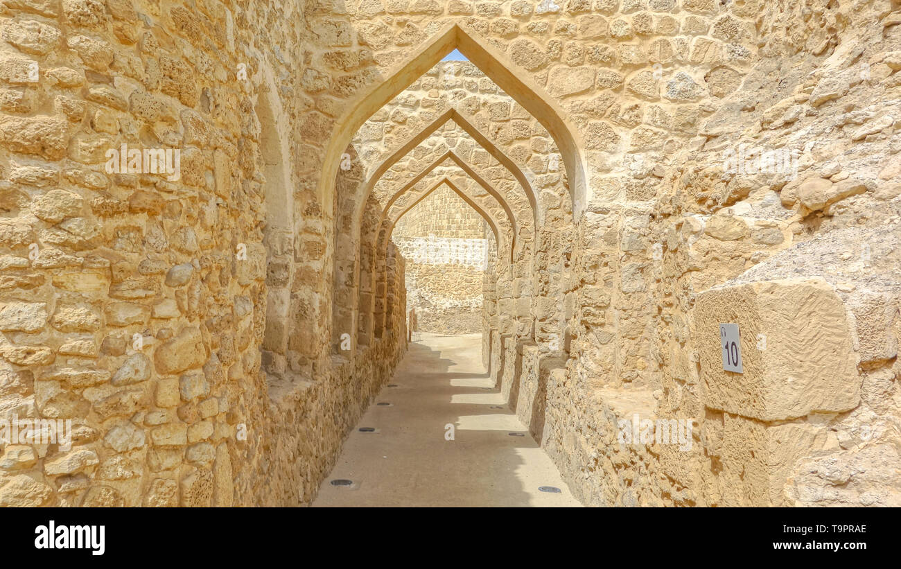 Several arches built with limestone boulders, Al Qalat Fort, Qal'at al-Bahrain - Stock Image