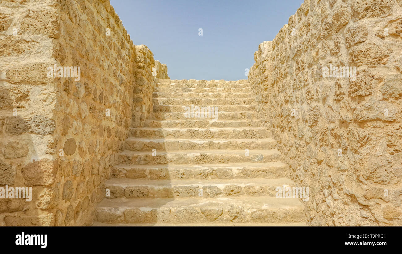 Staircase built with limestone boulders, Al Qalat Fort, Qal'at al-Bahrain - Stock Image