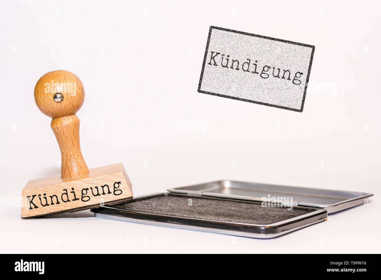 Rubber stamp on white background with the german word for 'termination' - Stock Image