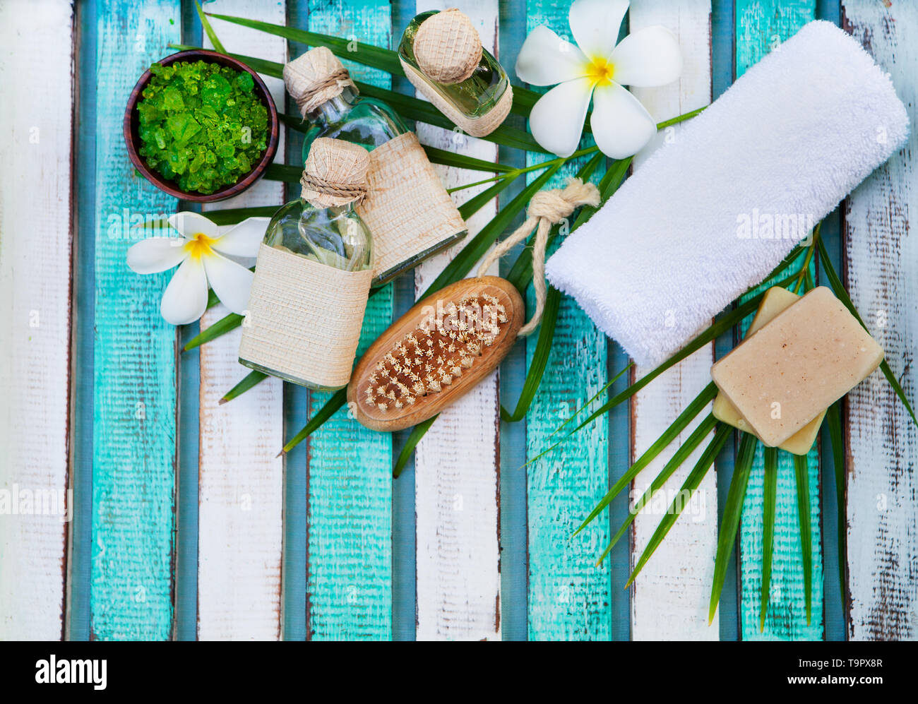 Spa and wellness massage setting. Still life with flower. Copy space. Top view. - Stock Image