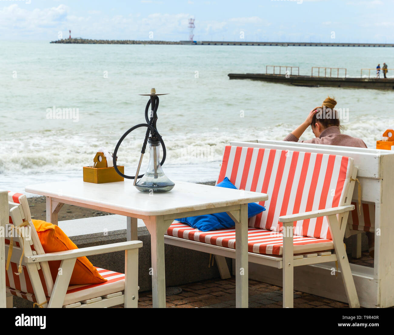 SOCHI,RUSSIA,  20 APRIL 2019 - Hookah on the table  of the beach coffee shop on embankment of the Black sea - Stock Image
