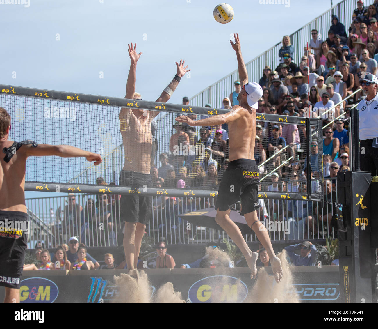 Jake Gibb hits over the block of Chase Budinger at the AVP Huntington Beach Open on 5 May 2019. (J. Geldermann/Alamy Live News) - Stock Image