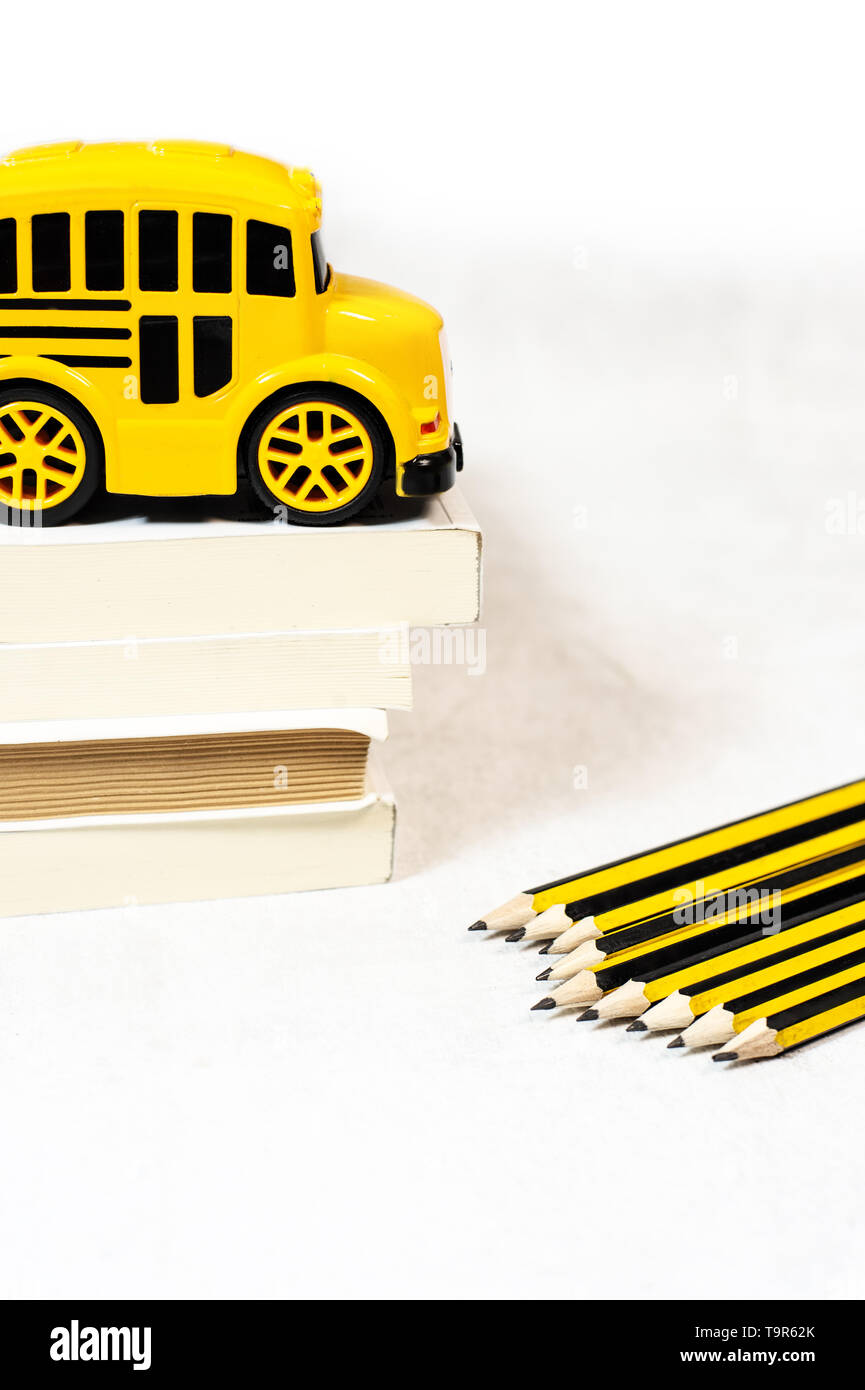Back to school concept with school bus toy, books - Stock Image